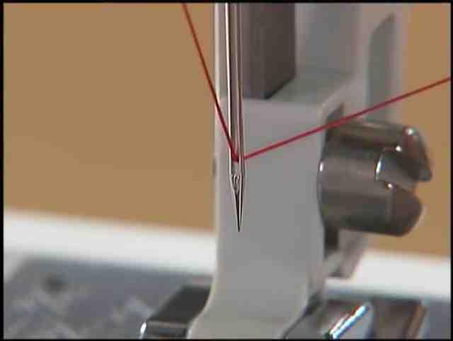 Comment mettre le fil dans la machine à coudre Kenmore?
